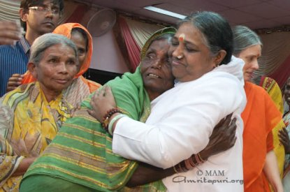 Amma gives darshan and embraces all who come to see her for hours and hours at a stretch.